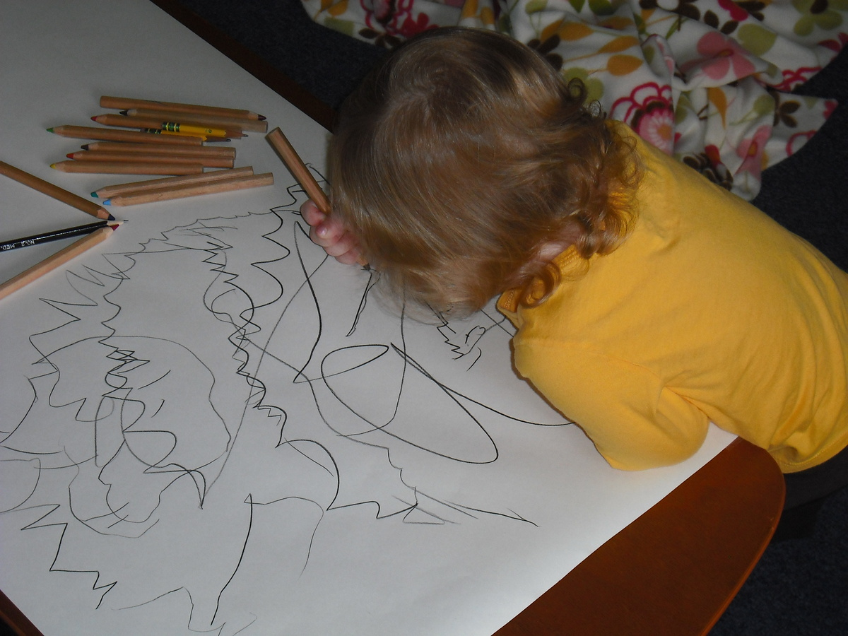 kid drawing or writing